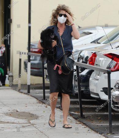 Stock Photo of Rachel Hunter seen walking with her dog