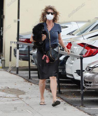 Rachel Hunter seen walking with her dog