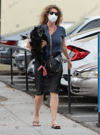 Stock Image of Rachel Hunter seen walking with her dog