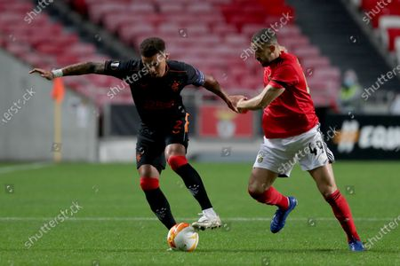 James Tavernier (L) of Rangers FC vies with Adel Taarabt of SL Benfica during the UEFA Europa League group D football match between SL Benfica and Rangers FC in Lisbon, Portugal on Nov. 5, 2020.