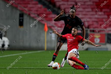 Adel Taarabt (front) of SL Benfica vies with Joe Aribo of Rangers FC during the UEFA Europa League group D football match between SL Benfica and Rangers FC in Lisbon, Portugal on Nov. 5, 2020.
