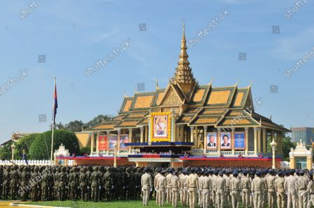 Soldiers take part in the celebration for the 10th anniversary of Cambodian King Norodom Sihamoni's coronation in Phnom Penh, Cambodia, Oct. 29, 2014.   Cambodia is time-honored for its rich history and representation of traditions. Phnom Penh, capital of Cambodia, lying at the confluence of the Tonle Sap and Mekong river systems, boasts of its traditional buildings and modern skyscrapers.