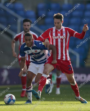 Andy Rinomhota of Reading and Nick Powell of Stoke City compete for the ball