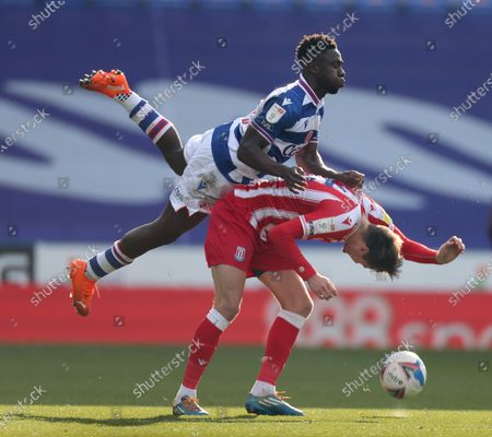 Stock Image of Nick Powell of Stoke City is fouled by Andy Yiadom of Reading