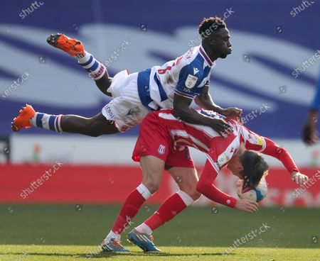 Stock Picture of Nick Powell of Stoke City is fouled by Andy Yiadom of Reading