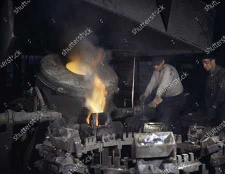 Worker Casting a Billet from an Electric Furnace, Chase Brass and Copper Co., Euclid, Ohio, USA, Alfred T. Palmer, U.S. Office of War Information, February 1942