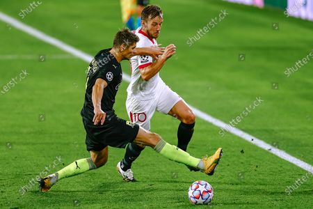 Ivan Rakitic of Sevilla FC and Daniil Utkin of FC Krasnodar