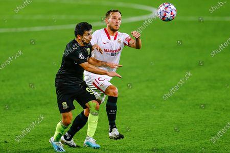 Ivan Rakitic of Sevilla FC and Shapi Suleymanov of FC Krasnodar