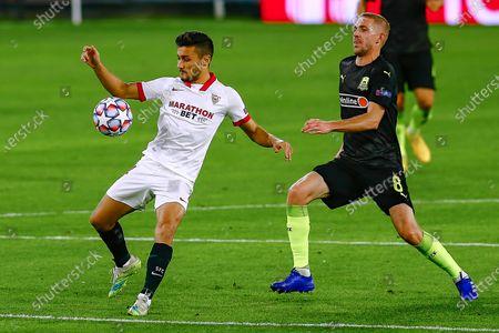 Oscar Rodr?guez of Sevilla FC and Yuri Gazinskiy of FC Krasnodar