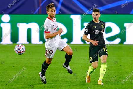 Eduard Spertsyan of FC Krasnodar and Ivan Rakitic of Sevilla FC