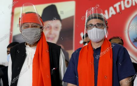 Member of Parliament and President of National Conference (NC) Dr Farooq Abdullah (R) along with his son and former Chief Minister, Omar Abdullah gesture during workers meeting in Jammu, India, 06 November 2020. National Conference held their first political workers meet in Jammu after Government of India abrogated Article 370 on 05 August 2019 from Jammu and Kashmir.