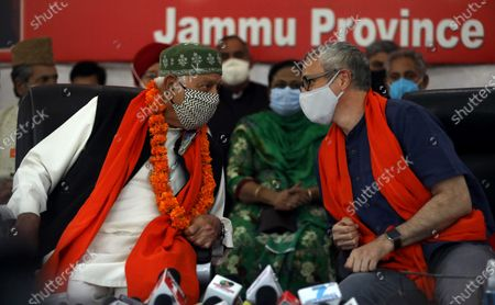 Member of Parliament and President of National Conference (NC) Dr Farooq Abdullah (R) discusses with his son and former Chief Minister, Omar Abdullah during workers meeting in Jammu, India, 06 November 2020. National Conference held their first political workers meet in Jammu after Government of India abrogated Article 370 on 05 August 2019 from Jammu and Kashmir.