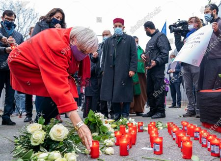 Vice President of the German Parliament Claudia Roth places a candle after an interconfessional prayer for the victims of the Vienna terror attack at the Austrian embassy in Berlin, Germany, 06 November 2020.