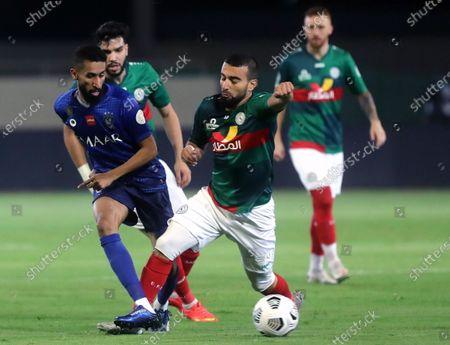 Al-Ettifaq's player Naim Sliti (R) in action against Al-Hilal's Salman Al-Faraj (L) during the Saudi Professional League soccer match between Al-Ettifaq and Al-Hilal at Prince Saud bin Jalawi Stadium in Dammam, Saudi Arabia, 06 November 2020.