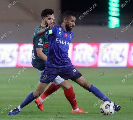 Al-Ettifaq's player Walid Azarou (back) in action against Al-Hilal's Salman Al-Faraj (front) during the Saudi Professional League soccer match between Al-Ettifaq and Al-Hilal at Prince Saud bin Jalawi Stadium in Dammam, Saudi Arabia, 06 November 2020.
