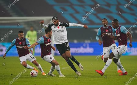 Ruben Loftus-Cheek of Fulham marked by four West Ham players