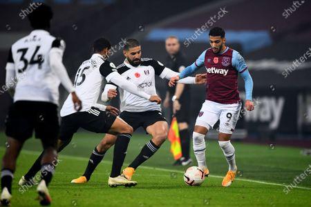Said Benrahma of West Ham United competes with Ruben Loftus-Cheek and Aleksander Mitrovic of Fulham