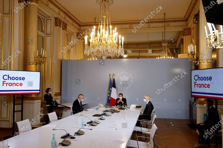 "French President Emmanuel Macron (C), flanked by French Economy and Finance Minister Bruno Le Maire (L) and French Junior Minister of Foreign Trade Franck Riester (R), chairs a video conference with foreign companies executives at the Elysee Palace in Paris, France, 06 Novembe 2020. The meeting is part of a ""mini choose France"" forum, designed to attract more foreign businesses."