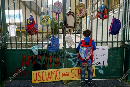 Backpacks suspended or attached to closed school gates during the protest in Naples, Italy, 06 November 2020. The 'Mamme no Dad' demonstrations were held in front of numerous city institutes where they also display signs and drawings as mothers and children protest in Naples against the order of Vincenzo De Luca, president of the Campania Region, which keeps schools closed, despite the classification of the yellow zone for the region.