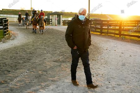 Stock Photo of Horse trainer Bob Baffert walks through the stable area during morning workouts for the Breeders' Cup World Championship horse races at Keeneland Race Course, in Lexington, Ky