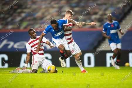 Jermain Defoe of Rangers  is fouled in the box by Hakeem Odoffin of Hamilton Academical and Will Collar of Hamilton Academical.