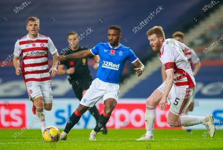 Jermain Defoe of Rangers plays the ball beyond Brian Easton of Hamilton during the Scottish Premiership match between Rangers & Hamilton Academical at Ibrox Stadium, Glasgow on 08 Nov 2020