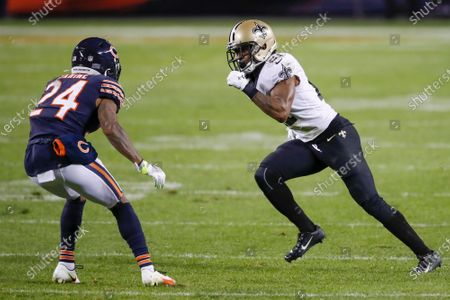 Chicago Bears cornerback Buster Skrine (24) defends against New Orleans Saints cornerback Patrick Robinson (21) during the overtime of an NFL football game, in Chicago