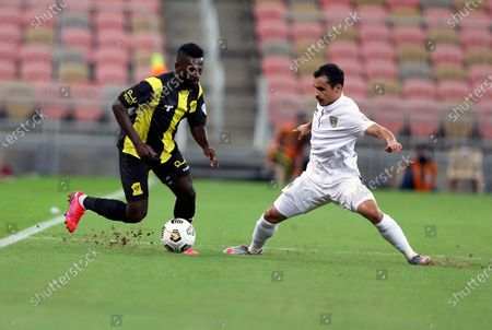 Stock Picture of Al-Ittihad's player Abdulaziz Al-Bishi (L) in action against Al-Taawoun's Abdullah Al-Jouei (R) during the Saudi Professional League soccer match between Al-Ittihad and Al-Taawoun at King Abdullah Sport City Stadium, 30 kilometers north of Jeddah, Saudi Arabia, 06 November 2020.