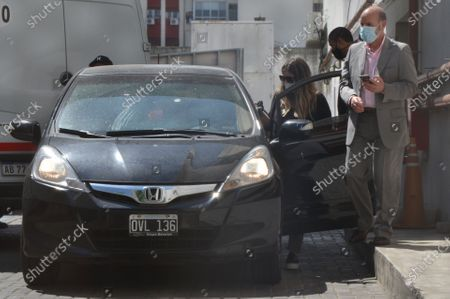 Dalma Maradona (2-R) arrives at the Olivos clinic to visit her father, Diego Maradona, in Buenos Aires, Argentina, 06 November 2020. Soccer star Diego Maradona, who was hospitalized last Monday and subsequently operated on for brain swelling, insists on leaving the hospital, although his doctor declines to discharge him so that he can continue with recovery. 'I think this is the first time or one of the few times that Diego is told no. I think he needs a lot of care, we all know that Diego needs a lot of care' he said on 06 November, in statements to the press, the Dr. Leopoldo Luque, his personal physician.