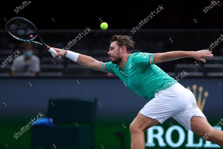 Stock Picture of Switzerland's Stan Wawrinka returns the ball to Germany's Alexander Zverev during their quarter-final game of the Paris Masters tennis tournament at the Bercy Arena in Paris