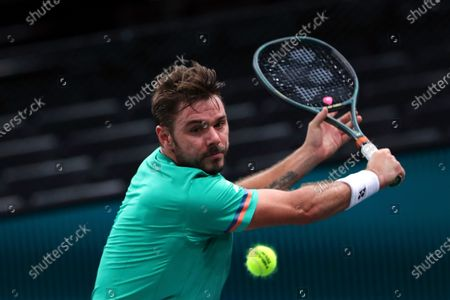 Stock Photo of Switzerland's Stan Wawrinka returns the ball to Germany's Alexander Zverev during their quarter-final game of the Paris Masters tennis tournament at the Bercy Arena in Paris