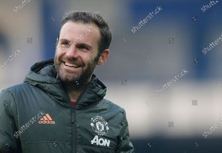 Juan Mata of Manchester United walk off the pitch at the end of the match