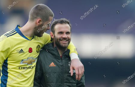 Manchester United goalkeeper David de Gea and Juan Mata of Manchester United walk off the pitch at the end of the match