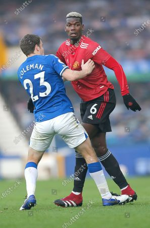 Paul Pogba of Manchester United and Seamus Coleman of Everton