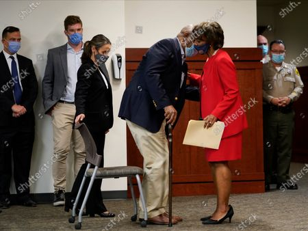 Los Angeles District Attorney Jackie Lacey kisses her husband, David Lacey before conceding to former San Francisco District Attorney George Gascon during a news conference at the Hall of Justice in Los Angeles