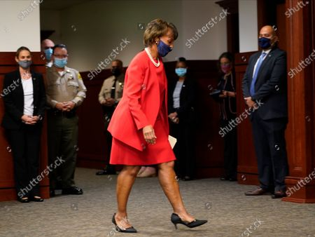 Los Angeles District Attorney Jackie Lacey walks to the podium to concede to former San Francisco District Attorney George Gascon during a news conference at the Hall of Justice in Los Angeles