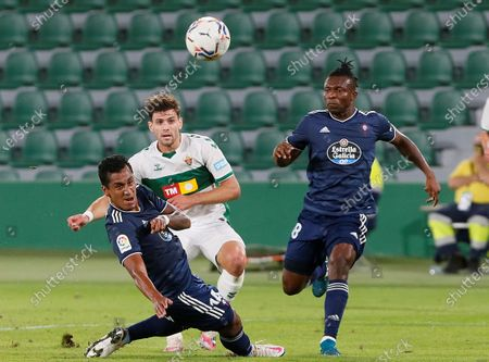 Elche's striker Lucas Boye (C) vies for the ball with Celta's midfielder Renato Tapia (L) and defender Joseph Aidoo (R) during the Spanish LaLiga soccer match between Elche CF and Real Club Celta Vigo held at Martinez Valero stadium in Elche, Alciante, eastern Spain, 06 November 2020.