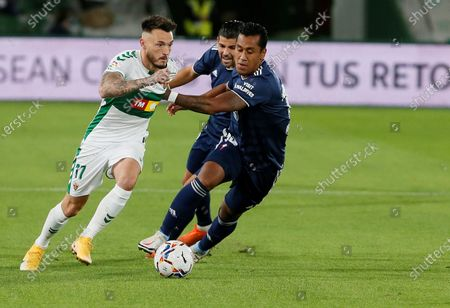 Elche's striker Josan (L) vies for the ball with Celta's midfielder Renato Tapia (R) during the Spanish LaLiga soccer match between Elche CF and Real Club Celta Vigo held at Martinez Valero stadium in Elche, Alciante, eastern Spain, 06 November 2020.