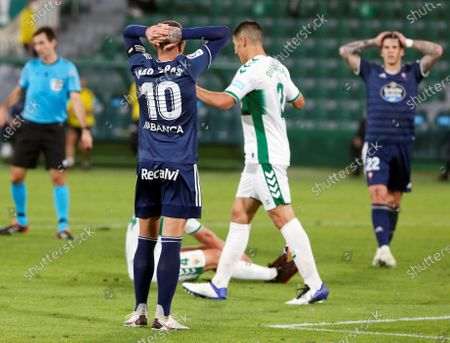 Celta's striker Iago Aspas (L) reacts during the Spanish LaLiga soccer match between Elche CF and Real Club Celta Vigo held at Martinez Valero stadium in Elche, Alciante, eastern Spain, 06 November 2020.