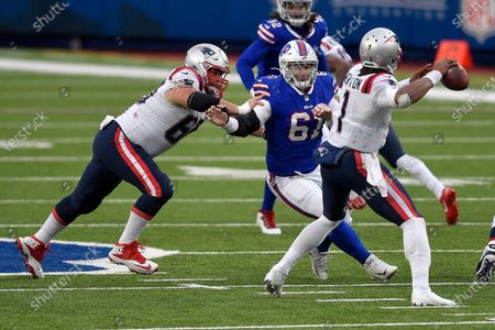 Buffalo Bills defensive tackle Justin Zimmer (61) gets by New England Patriots center David Andrews (60) to pressure quarterback Cam Newton (1) during the second half of an NFL football game, in Orchard Park, N.Y