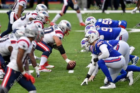 New England Patriots center David Andrews (60) prepares to snap the ball against the Buffalo Bills during the second half of an NFL football game, in Orchard Park, N.Y