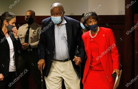 Los Angeles County District Attorney Jackie Lacey holds hands with her husband David Lacey as she enters the room to address media and a small crowd of supporters regarding her concession to opponent George Gascon at the Hall of Justice in downtown Los Angeles Friday morning. Hall Of Justice on Friday, Nov. 6, 2020 in Los Angeles, CA. (Al Seib / Los Angeles Times
