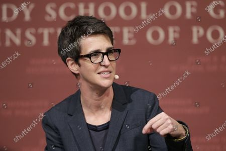 "Television anchor Rachel Maddow, host of ""The Rachel Maddow Show,"" moderates a panel at a forum called ""Perspectives on National Security,"" at the John F. Kennedy School of Government, at Harvard University, in Cambridge, Mass. MSNBC's Rachel Maddow said she is quarantining after being in contact with someone who tested positive for the coronavirus. Maddow said on social media that she tested negative so far for COVID-19 but plans to remain at home until it's ""safe for me to be back at work without putting anyone at risk"