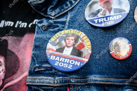 A closeup of a Barron Trump button is seen as Trump supporters gather outside of the Pennsylvania Convention Center as Americans await election results in the 2020 Presidential Election on Friday, Nov. 6, 2020, in Philadelphia, PA.