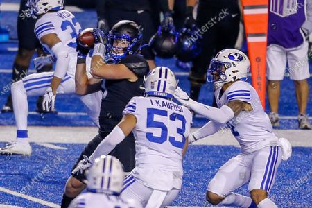 Boise State tight end Riley Smith (3) catches the ball as BYU linebacker Isaiah Kaufusi (53) and BYU defensive back Troy Warner (4) close in during the second half in an NCAA college football game, in Boise, Idaho. BYU won 51-17