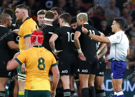 Referee Nick Berry, right, shows a red card to Australia's Lachie Swinton for a dangerous tackle during the Bledisloe rugby test between Australia and New Zealand at Suncorp Stadium, Brisbane, Australia, Saturday, Nov.7, 2020