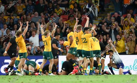 Referee Nick Berry, right, awards a try to Australia during the Bledisloe rugby test between Australia and New Zealand at Suncorp Stadium, Brisbane, Australia, Saturday, Nov.7, 2020