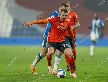 James Bree of Luton Town shields the ball from Harry Toffolo of Huddersfield Town; 7th November 2020 The John Smiths Stadium, Huddersfield, Yorkshire, England; English Football League Championship Football, Huddersfield Town versus Luton Town.