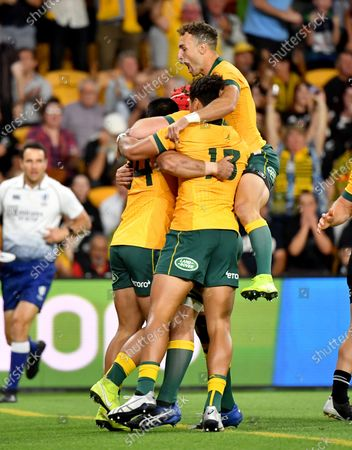 Tom Wright (L) of the Wallabies celebrates scoring during the Tri-Nations rugby union match between the Australian Wallabies and the New Zealand All Blacks, at Suncorp Stadium in Brisbane, Australia, 07 November 2020.