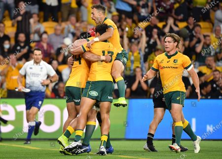 Tom Wright (L) of the Wallabies celebrates scoring a try with team mates during the Tri-Nations rugby union match between the Australian Wallabies and the New Zealand All Blacks, at Suncorp Stadium in Brisbane, Australia, 07 November 2020.